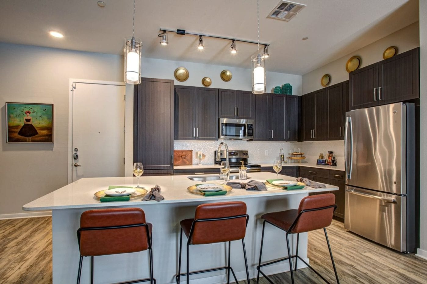 Apartments in Phoenix, AZ - Kitchen with Stainless Steel Appliances and Large Bartop Island