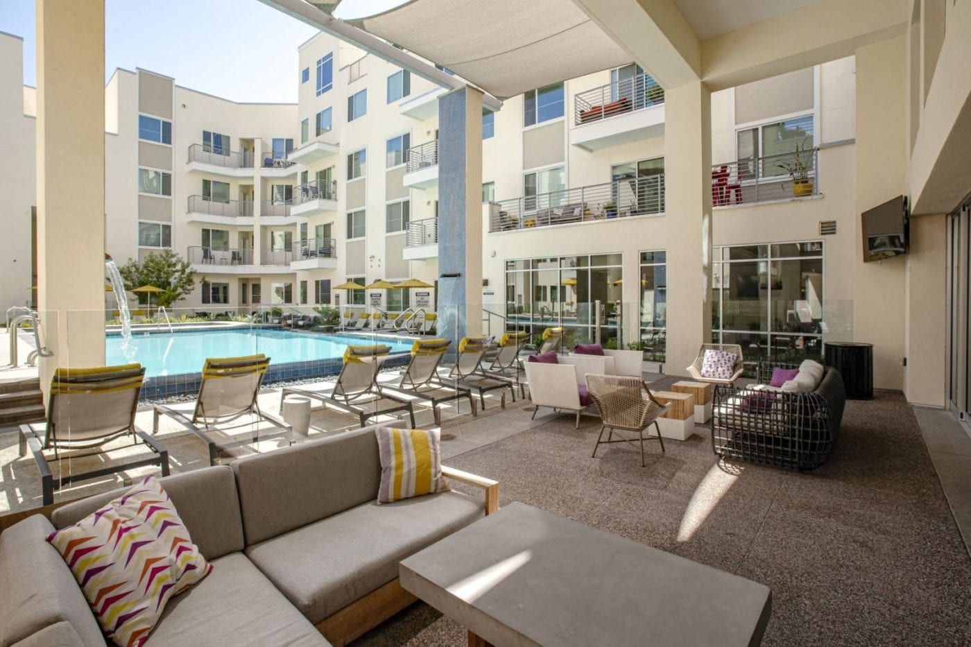 Pet Friendly Apartments in Phoenix, AZ - Outdoor Lounge Next to Pool with Modern Decor and TV