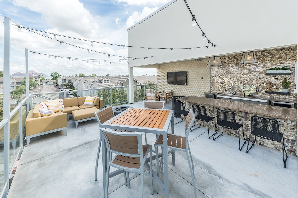 Phoenix, AZ Apartments for Rent - Vela on Camelback Sky Deck with Hanging Lights and Bar Kitchen